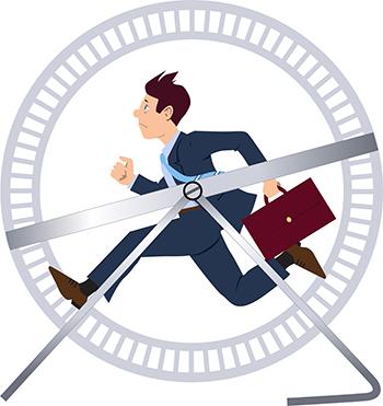 Businessman running in a hamster wheel
